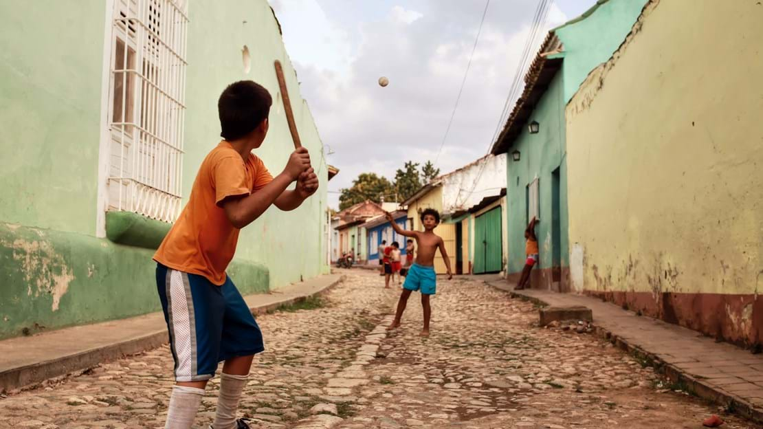 shutterstock_464100611 TRINIDAD - CUBA  12.03.2015 Kids are playing baseball in the streets in Trinidad.jpg