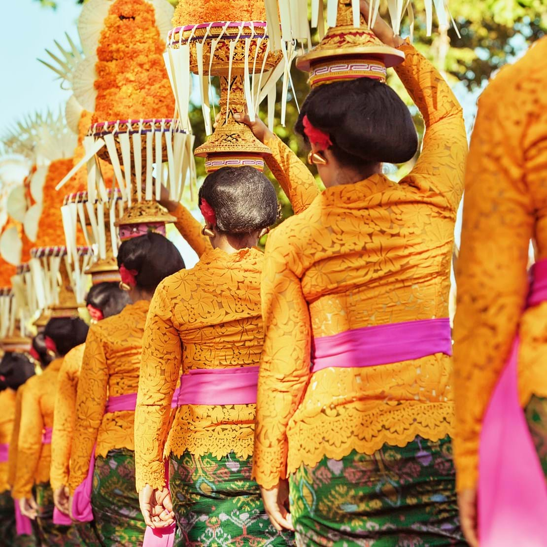 shutterstock_308561210 Procession of beautiful Balinese women in traditional costumes - sarong, carry offering on heads for Hindu ceremony. Arts festival, culture of Bali island and Indonesia people, Asian.jpg