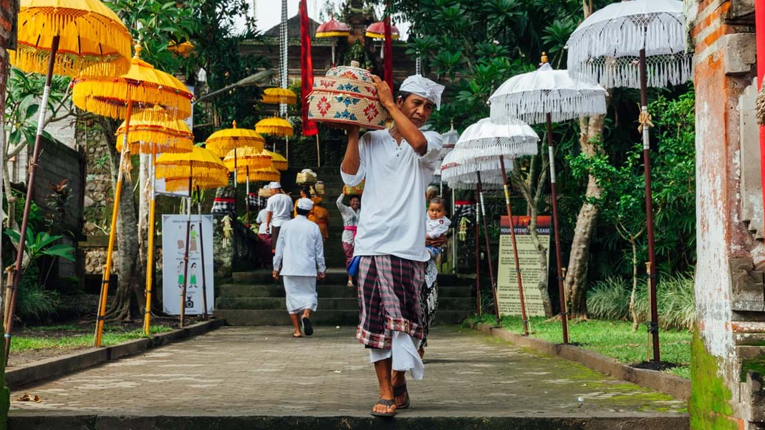 Balinese man in traditional clothes during the celebration before Nyepi Ubud.jpg