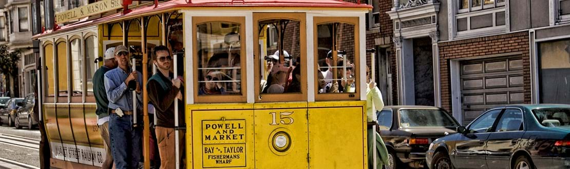 shutterstock_99760811 SAN FRANCISCO Ca. - MAY 6 Passengers ride in a cable car.jpg