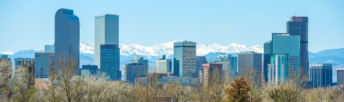 shutterstock_186925442 Sunny Denver Skyline. Spring in Colorado. Denver Skyline and Snowy Rocky Mountains..jpg