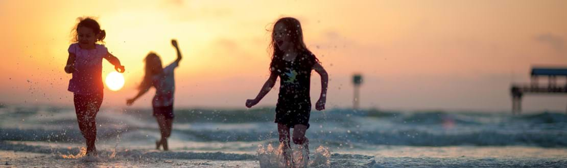 Courtesy_of_Visit_St._Pete_Clearwater_-_Young_Girls_(sunset_on_beach).jpg