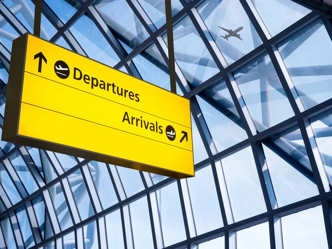 shutterstock_224405254 Check in, Airport Departure & Arrival information board sign.jpg