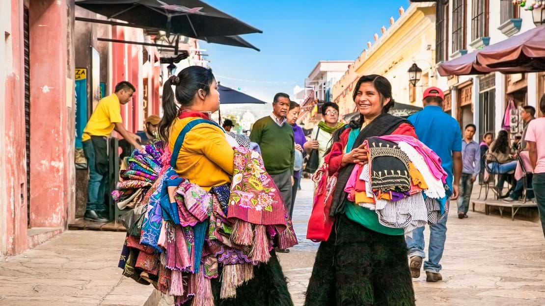 shutterstock_539658217 SAN CRISTOBAL, MEXICO-DEC 13, 2015Tzotzil Maya people saling the traditional clothes at street of San Cristobal de las casas.jpg