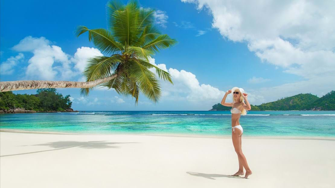 shutterstock_209085742 Cute blonde woman at tropical beach Baie Lazare at island Mahe, Seychelles.jpg