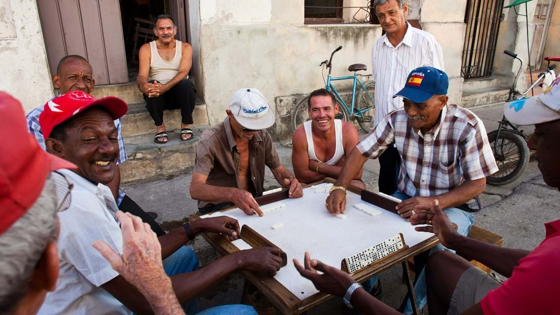 shutterstock_150009776 man play dominos on the street in Camaguey.jpg