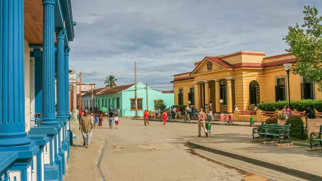 shutterstock_451773604 Street with colorful houses in colonial town Baracoa, Cuba.jpg