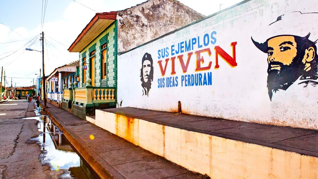 shutterstock_597146129 House facade in Baracoa with painted communist propaganda and Che Guevara image.jpg